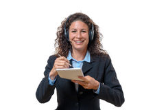 Smiling friendly businesswoman in a headset Royalty Free Stock Photography