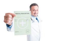 Smiling friendly doctor or medic showing medical prescription Stock Photo
