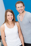 Smiling friendly fit young couple Stock Image