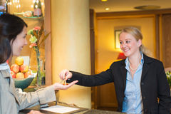 Smiling friendly hotel receptionist Royalty Free Stock Photo