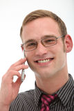 Smiling friendly man on mobile phone Stock Photography
