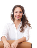 Smiling friendly office girl. Portrait of smiling friendly office girl wearing headset Royalty Free Stock Photos