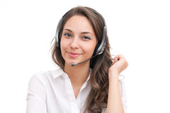 Smiling friendly office girl. Portrait of smiling friendly office girl wearing headset Stock Images