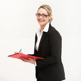 Smiling friendly secretary or assistant Stock Image