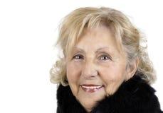 Smiling friendly senior woman Stock Photos