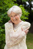 Smiling friendly senior woman Stock Image