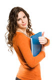 Smiling friendly young female student. Stock Photo