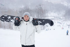 Smiling friendly young male snowboarder Royalty Free Stock Image