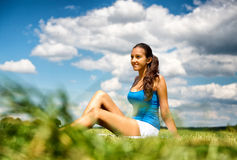 Smiling friendly young teenager in a field Stock Images