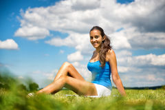 Smiling friendly young teenager in a field Royalty Free Stock Image