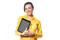 Smiling friendly young woman holding a tablet royalty free stock photography