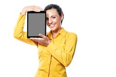 Smiling friendly young woman holding a tablet royalty free stock photos