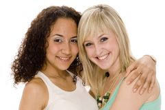 Smiling Friends. Two friends share a hug and smile Stock Photography