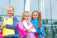 Smiling friends with backpacks Stock Photos