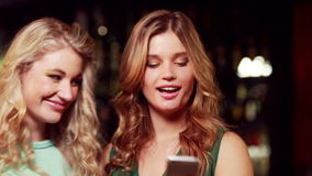 Smiling friends with champagne taking selfie stock video footage