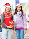 Smiling Friends With Christmas Gift Stock Images