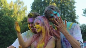 Smiling friends colored with powder paint having fun and posing for camera. Stock footage stock video footage