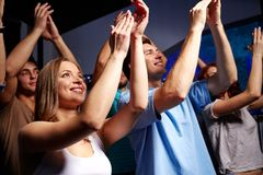 Smiling friends at concert in club Stock Photo