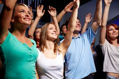 Smiling friends at concert in club Royalty Free Stock Photos