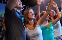 Smiling friends at concert in club Stock Images