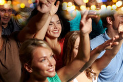 Smiling friends at concert in club Royalty Free Stock Image