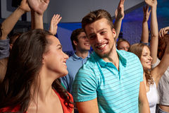 Smiling friends at concert in club Stock Image