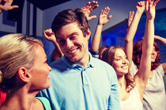 Smiling friends at concert in club Royalty Free Stock Images