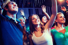Smiling friends at concert in club Royalty Free Stock Photography
