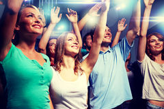 Smiling friends at concert in club Royalty Free Stock Photo