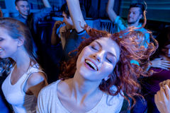 Smiling friends dancing in club Stock Photos