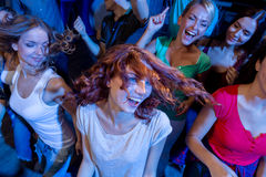 Smiling friends dancing in club Stock Image