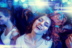Smiling friends dancing in club Royalty Free Stock Photo