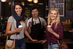 Smiling friends enjoying coffee Royalty Free Stock Photography