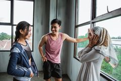 Smiling friends after exercising at the gym talking stock photos