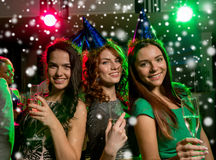 Smiling friends with glasses of champagne in club Royalty Free Stock Photo