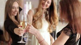 Smiling friends with glasses of champagne dancing at the bachelorette party. Smiling friends with glasses of champagne dancing in club at the bachelorette party stock video footage