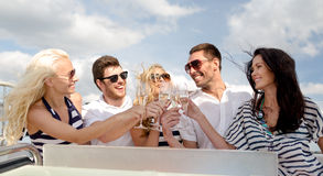 Smiling friends with glasses of champagne on yacht Royalty Free Stock Photo