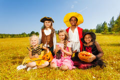 Smiling friends in Halloween costumes  together Royalty Free Stock Images