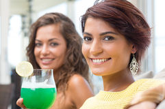Smiling Friends At Happy Hour Stock Photo