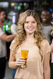 Smiling friends having beers Royalty Free Stock Photos