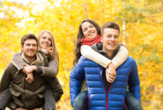 Smiling friends having fun in autumn park Royalty Free Stock Photo