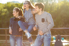Smiling friends having fun outdoors Stock Photo