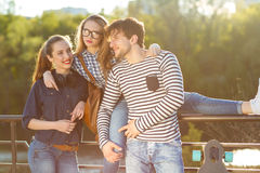 Smiling friends having fun outdoors Royalty Free Stock Image