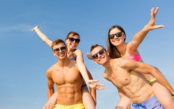 Smiling friends having fun on summer beach Royalty Free Stock Photo