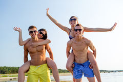 Smiling friends having fun on summer beach Stock Image