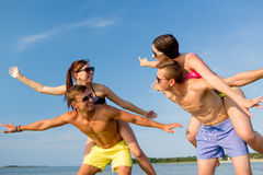 Smiling friends having fun on summer beach Stock Photo