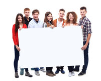 Smiling friends holding blank banner Royalty Free Stock Photo