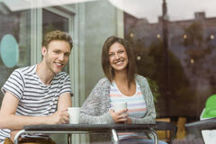 Smiling friends holding mug of coffee Stock Photography