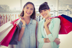 Smiling friends holding shopping bags Royalty Free Stock Photos