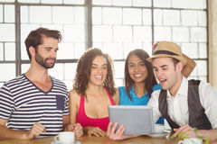 Smiling friends looking at tablet computer Royalty Free Stock Photo